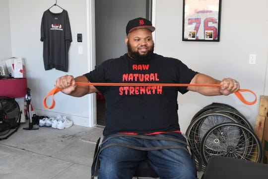 Antonio Martin, wounded in a Detroit shooting and ranked 6th in the world as a power lifter warms-up before his bench press. Martin, is set to qualify on the US Paralympic Team for the Tokyo 2020 Summer Games.