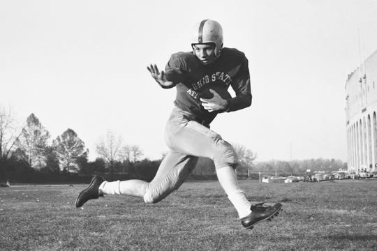 "This 1953 file photo, shows Ohio State halfback Howard ""Hopalong"" Cassady in action pose in Columbus, Ohio."