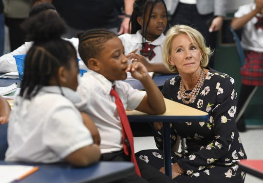 U.S. Education Secretary Betsy DeVos with Detroit Edison Public School Academy student Amir Brown during a visit on Friday.
