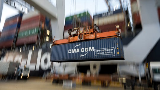 FILE - In this June, 19, 2018, file photo, a ship to shore crane lifts a CMA CGM Group shipping container onto the Hapag-Lloyd Teno at the Port of Savannah in Savannah, Ga. Manufacturers are facing stunted growth amid the damaging trade war between the U.S. and China, and that has some on Wall Street worried that it will crimp the consumer-fueled economy.