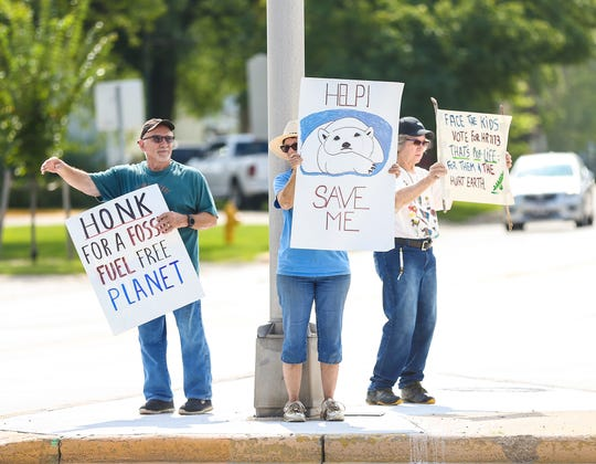 Richard Freund, Cathleen Ford and Judy Hollis of Fond du Lac protest conditions that they say are causing climate change to the earth Friday, September 20, 2019 at the intersection of Main Street and Pioneer Road in Fond du Lac, Wis. Doug Raflik/USA TODAY NETWORK-Wisconsin