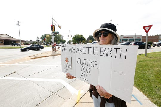 Barbara Kalwaitis of Fond du Lac protests conditions that she says are causing climate change to the earth Friday, September 20, 2019 at the intersection of Main Street and Pioneer Road in Fond du Lac, Wis. Doug Raflik/USA TODAY NETWORK-Wisconsin