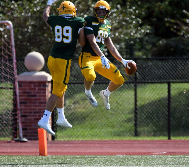 St. Norbert College wideout Samuel Staehling (80) celebrates with teammate Mark Molitor (89) after his 90-yard touchdown Sept. 14 against UW-Eau Claire.
