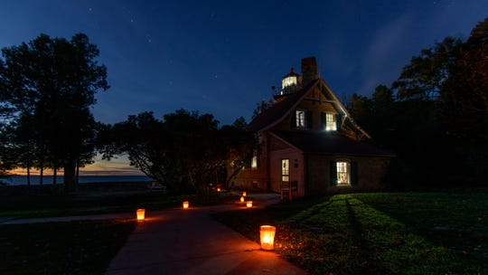 A lighted path leads the way to Eagle Bluff Lighthouse and its shining Fresnel lens at a past Twilight Tours, Tunes & Tales.