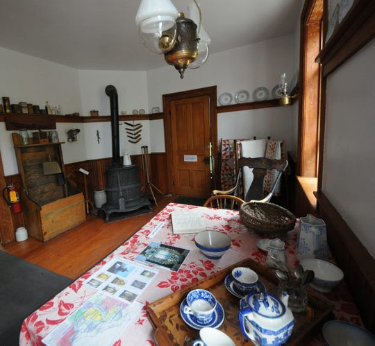 One of the rooms at Eagle Bluff Lighthouse Museum as it would have looked during Capt. William Duclon's tenure there, from 1883 to 1918.  Visitors to the light's Twilight Tours, Tunes & Tales can view this and other rooms by lantern light after dusk.