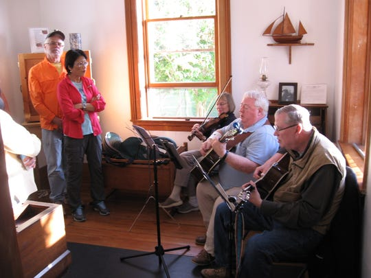 Musicians perform for guests during a past Twilight Tours, Tunes & Tales at Eagle Bluff Lighthouse Museum.