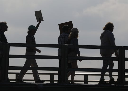 Protesters march during the Green Bay Climate Strike rally hosted by Youth Climate Action Team. About 100 people gathered on Friday afternoon at CityDeck for the Global Climate Strike, a call for action on climate change. Rallies were held across the United States and in 156 countries.