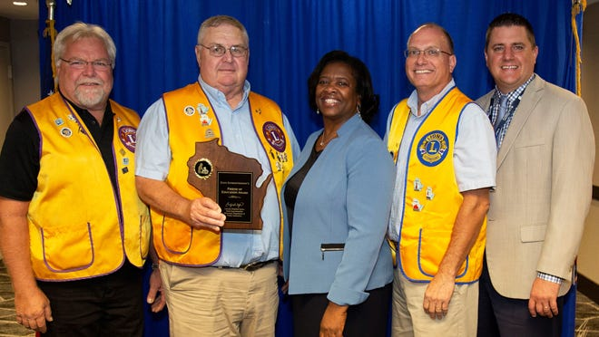 Members of the Lena Lions Club accepted a 2019 Friend of Education Award from State Superintendent Carolyn Stanford Taylor, center, on Thursday in Madison. Lions Club members accepting the award are, from left, Mike Diehlmann, Russ Glime,  Stanford Taylor, Dave Manning, and Ben Pytleski, who is also superintendent of the Lena School District.
