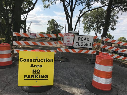 Signs posted at the site of a former bridge on Hampton Avenue in Greenville Thursday, Sept. 19, 2019, caution pedestrians not to approach a construction area where county officials said this week work will soon begin to install a new pedestrian bridge. The bridge, closed to vehicular traffic in 1994 and torn down in 2012, connected Southernside neighbors on either side of a Norfolk Southern rail yard.