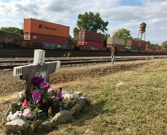 A man walks along a set of nine Norfolk Southern rail lines near Hampton Avenue in Greenville on Thursday, Sept. 19, 2019, close to the spot where a memorial still stands in honor of Ernestine Dixon, a 57-year-old woman who was struck by a train May 8, 2018, while trying to walk across the tracks to visit a friend on the other side .