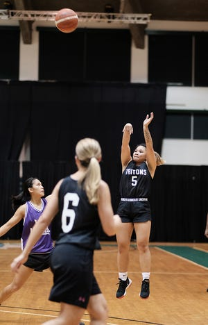The University of Guam's Shania Bulala takes a shot against a Team Legends defender. The Lady Tritons blew out Team Legends 63-36 at the UOG Calvo Field HouseSept. 18 in the PBS Guam Women's Basketball League.