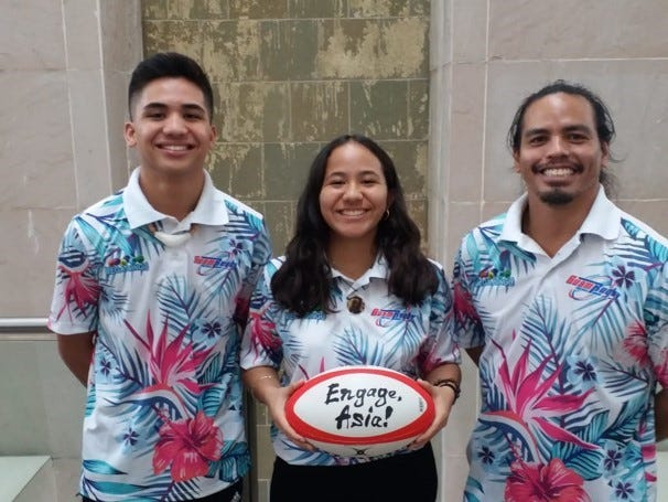 Miguel and Isabella Hernandez with Guam National Rugby Team's Paul Claros. The Hernandezes representing Guam at celebrations in Japan for the opening of the 2019 Rugby World Cup.