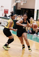 Taneea Henderson from Fuetsa plays defense on the LadyTritons' Danica Cabrera during a recent PBS Guam Women's Basketball League game at the UOG Calvo Field House. Henderson, a student at Guam High, is considered one of the best players in the league.