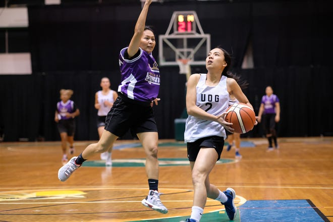 Team Legends Susan Lupola, left, defends a layup against University of Guam Lady Tritons Isla Quinata during a recent PBS Guam Women's Basketball League game at the UOG Calvo Field House.