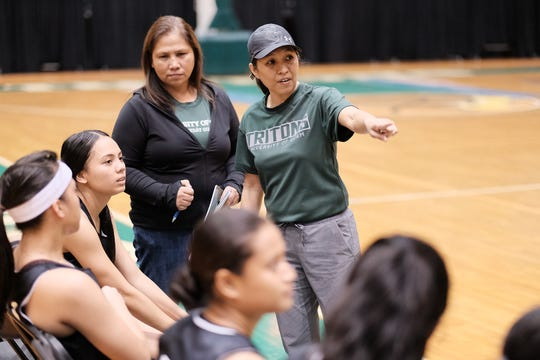 In this file photo, UOG Lady Tritons coach Cecile Olandez talks to her team during a recent PBS Guam Women's Basketball League game at the University of Guam Calvo Field House.