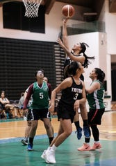 UOG Lady Tritons' Niah Siguenza goes up for a rebound against the UOG Tridents in the PBS Guam Women's Basketball League at the University of Guam Calvo Field House in this file photo.