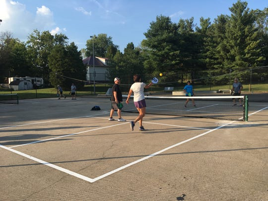 A group of local pickleball enthusiasts play doubles recently on both courts at Community Park, 1776 Atkinson St.