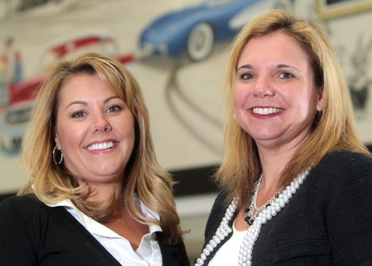 Courtney Cox Cole (right) with sister, Monica Peck, left, in 2012. The two women owned Hare Chevrolet in Noblesville until 2017.