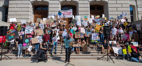Don Piper, a student at Herron High School, fires up he crowd with some chants during the event. A crowd of a few hundred gathered for a rally on the south lawn of the Indiana State House Friday, Sept. 20, 2019 to show support for the Global Climate Strike.