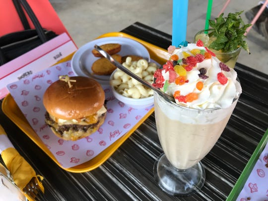 The Fruity Pebble cereal milk milkshake has bright mango flavor at Baby's Diner in Indianapolis. The restaurant opened Sept. 20, 2019, at 2147 N. Talbott St., at Herron Morton.