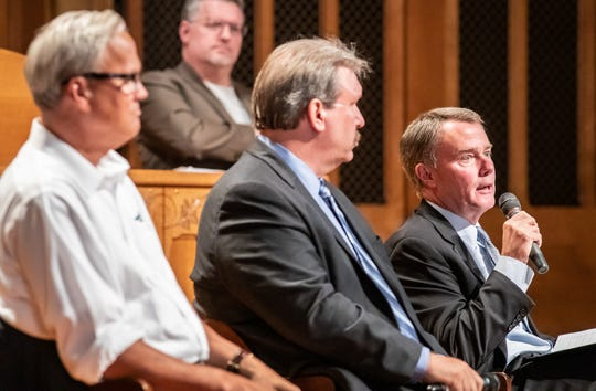 Left to right, State Sen. Jim Merritt, Libertarian candidate Douglas McNaughton, and Indianapolis Mayor Joe Hogsett, D-Indianapolis, participate in the Historic Urban Neighborhoods of Indianapolis and Indiana Landmarks Mayoral Forum on Neighborhoods at Indiana Landmarks,1201 N. Central Ave., Indianapolis, on Thursday, Sept. 19, 2019.