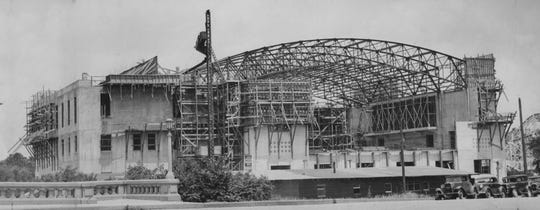The Heslar Naval Armory is shown being built by the Works Progress Administration in 1937.
