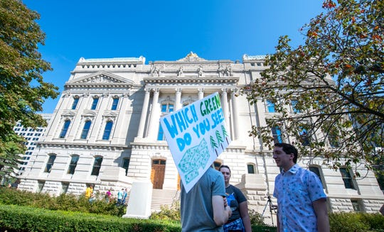 A crowd of a few hundred gathered for a rally on the south lawn of the Indiana State House Friday, Sept. 20, 2019 to show support for the Global Climate Strike.