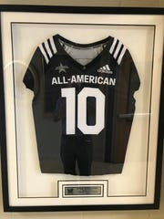 Notre Dame freshman Kyle Hamilton's jersey is displayed in the hallway outside Marist School's athletic offices