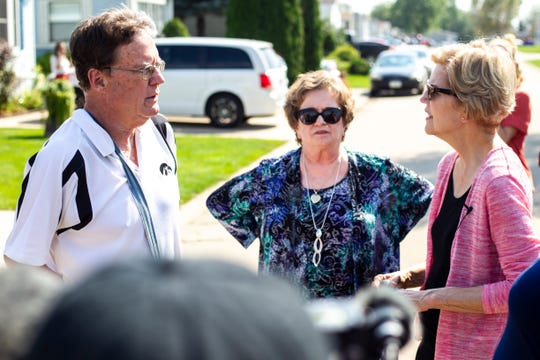 Democratic presidential candidate U.S. Sen. Elizabeth Warren, D-Mass., speaks with Don Lund and Candi Evans, of the Golfview Residents Association, while touring the Havenpark Capital owned mobile home park, Friday, Sept., 20, 2019, at the Golfview Mobile Home Park in North Liberty, Iowa.