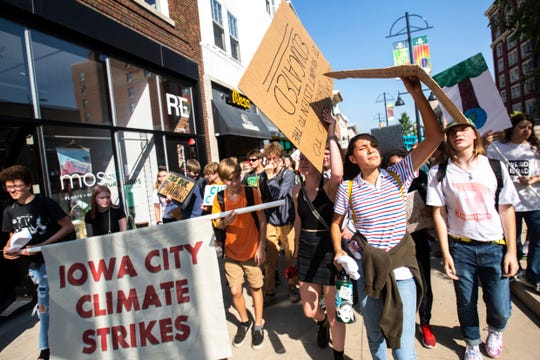 "Iowa City and University of Iowa students participate in a ""Global Climate Strike"" protest, Friday, Sept., 20, 2019, in Iowa City, Iowa."