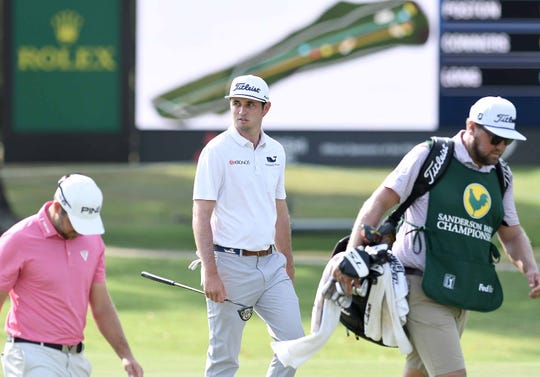J.T. Poston (center) walks up the 18th fairway at the Sanderson Farms Championship on Friday, September 20, 2019, at the Country Club of Jackson in Jackson, Miss.