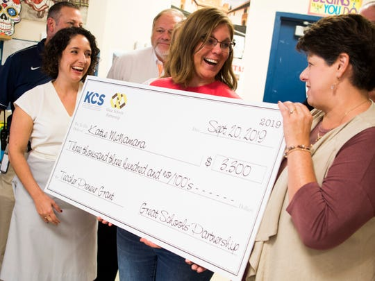 South-Doyle High teacher Katie McNamara, center, is presented a check for a $3,300 Great Schools Partnership grant in her classroom Sept. 20, 2019.