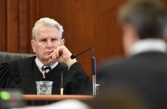 Tennessee Supreme Court Justice Gary Wade, left, listens to arguments on May 6, 2015.