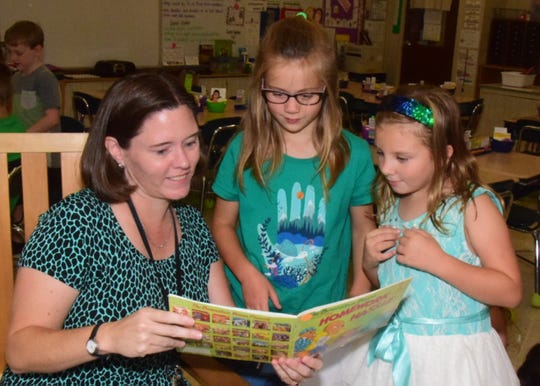 It's reading time for teacher Melanie Stone, Mia Kaufman and Lily Johnsen at Ball Camp Elementary School,  Wednesday, Sept 18. 2019
