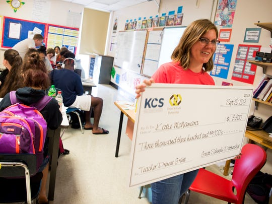 South-Doyle High teacher Katie McNamara is presented a check for a $3,300 Great Schools Partnership grant in her classroom Sept. 20, 2019.