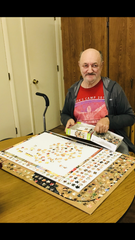 The Salvation Army's Samaritan Center client Bob Blosser works on a jigsaw puzzle Thursday at the center.
