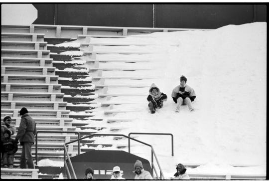 Fans sit on a snow bank at Spartan Stadium during MSU's 76-14 win over Northwestern on Nov. 18, 1989.