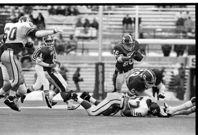 MSU running back Blake Ezor runs through Northwestern's defense on Nov. 18, 1989. Ezor scored six touchdowns that day.