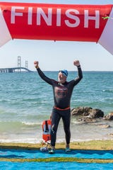 "Thomas Spangler finishing the ""Mighty Mac"" swim on Aug. 11, Spangler finished 20th in his division."