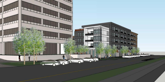 This rendering shows a proposed development at the site of the former Lake Trust Credit Union headquarters in downtown Lansing.