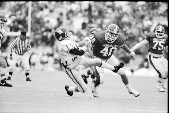 Northwestern QB Tim O'Brien is shoved to the ground during the Wildcats' 76-14 loss to MSU in 1989.