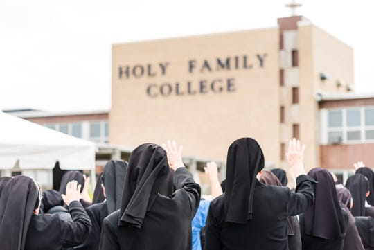 The Franciscan Sisters of Christian Charity offer a blessing during the Unveiling a New Chapter event at Holy Family College Sept. 19, 2019.