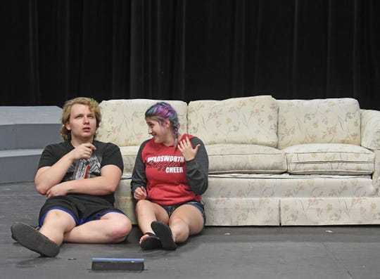 "Kyle Shope and Eryn Eshelman rehearse a scene from ""Connected"" on Thursday."