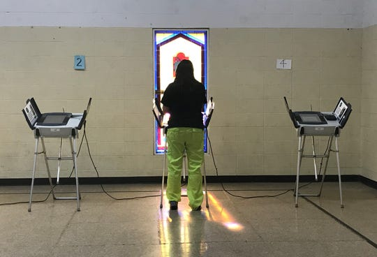 A voter cast her ballot for the 2019 Arlington municipal election at Arlington United Methodist Church.