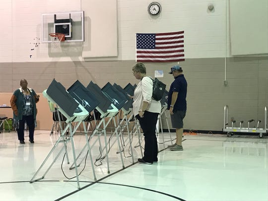 Voters cast their ballots for the 2019 Arlington municipal election at Arlington Middle School.