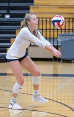 Lake Country Lutheran senior Rylee Vaughn, a Midwest Classic first-team all-conference selection, bumps during a match at home against HOPE Christian.