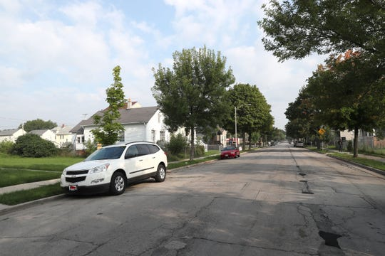 The 2600 block of North Fifth  Street in Milwaukee where a woman who was driving her car with two children and another woman in it was struck and killed by stray gunshots fired between people on the street.