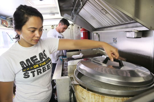 "Alexa Alfaro, Matt Alfaro and a third sibling, Christian Alfaro (not pictured) are competing on a new Food Network show called ""Family Restaurant Rivals."" Alexa and Matt Alfaro operate the Filipino food stand and food truck Meat on the Street in Milwaukee."