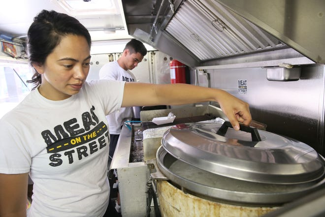 """Alexa Alfaro, Matt Alfaro and a third sibling, Christian Alfaro (not pictured) are competing on a new Food Network show called """"Family Restaurant Rivals."""" Alexa and Matt Alfaro operate the Filipino food stand and food truck Meat on the Street in Milwaukee."""