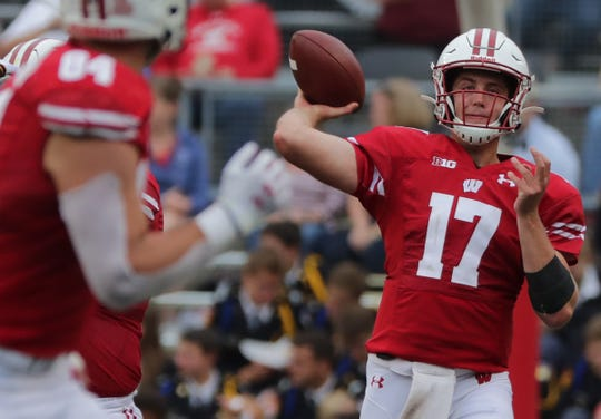 Wisconsin quarterback Jack Coan throws a pass to tight end Jake Ferguson during their game Sept. 7.